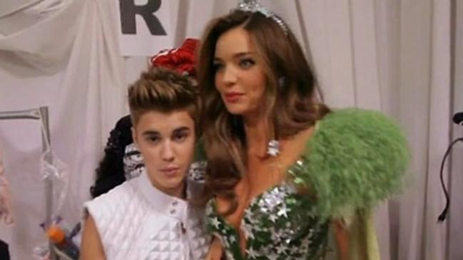 Justin Bieber up close with Miranda Kerr at the 2012 NYC Victoria's Secret show. Picture: CBS/Victoria's Secret