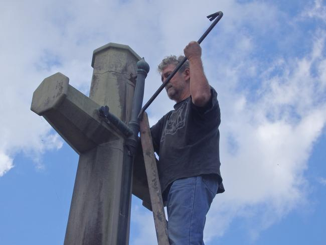 The Catholic Worker movement supplied pics of the Toowong Cemetery vandalism being carried out.
