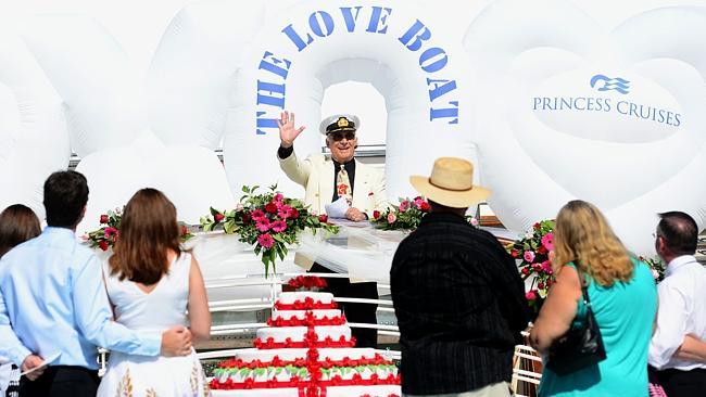 Gavin MacLeod presides at the mass wedding vow renewal on the Sun Princess.