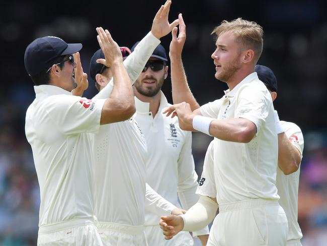 England's Stuart Broad (right) celebrates with his teammates after taking the wicket of Australia's Cameron Bancroft during the fifth Ashes Test. (AAP Image/David Moir)