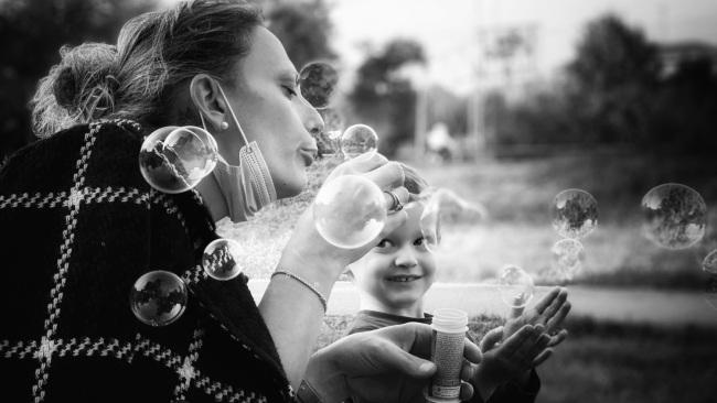 "7/10Best 'Close to Home' photoFidenza, Italy Photographer's comments: ""It was the beginning of autumn and one of the last days on which to take the advantage of being out in the park for some hours. My friend Giulia and her son were playing with soap bubbles.""- Pier Luigi Dodi"