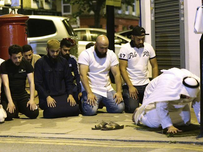 The fatal attack has been called an attack on Muslims. Local people observe prayers at Finsbury Park where a vehicle struck pedestrians in London. Picture: Yui Mok/PA via AP