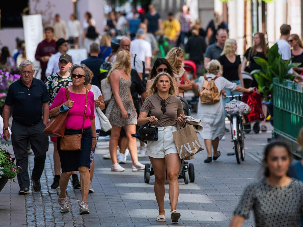 Crowds of people walk in Stockholm, where social distancing and lockdown measures are recommended but not mandated. Picture: Jonathan Nackstrand/AFP