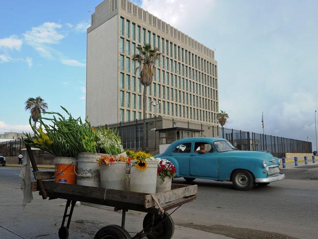This hoto taken on December 17, 2015 shows a cart with flowers next to the US Embassy in Havana. No fewer than 16 Americans were hurt in what has previously been dubbed an acoustic attack on the US mission in Cuba. Picture: Yamil Lage