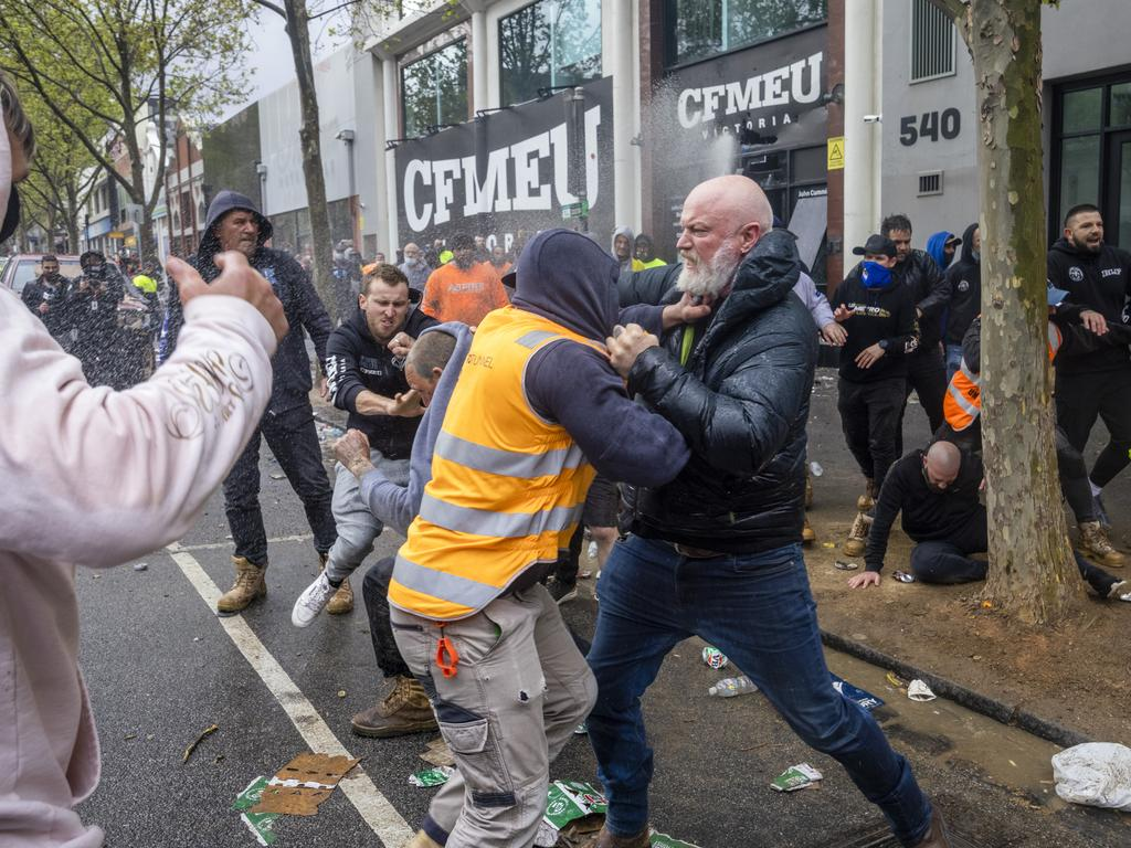 Men brawl outside the CFMEU headquarters during a protest about mandatory vaccination in the construction industry. Picture: David Geraghty