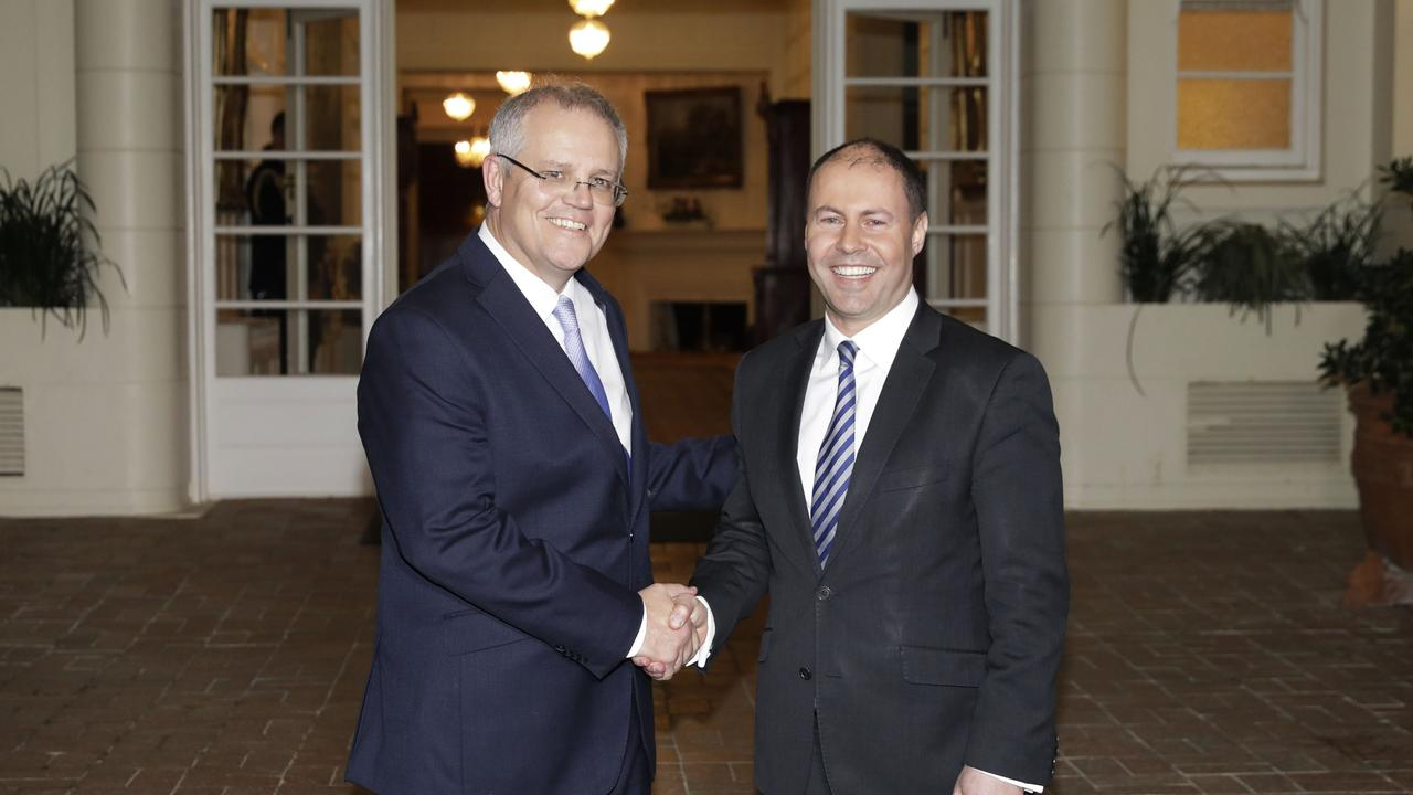 Prime Minister Scott Morrison and Treasurer Party Josh Frydenberg at Government House in Canberra after being sworn in by the Governor General Sir Peter Cosgrove. Picture by Sean Davey.
