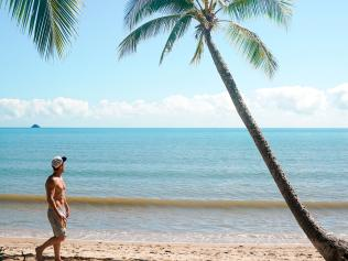 Tyson-taking-a-stroll-on-one-of-the-many-beaches-you-can-find-around-Cairns  escape  november 22 2020  tyson
