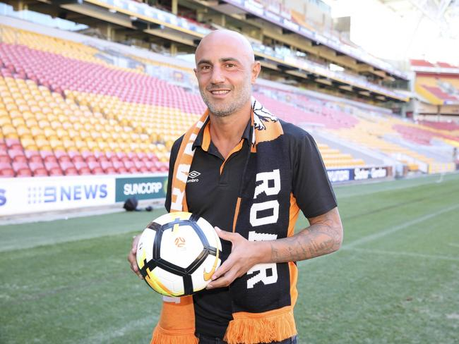 New Brisbane Roar striker Massimo Maccarone is still waiting for his visa to clear.