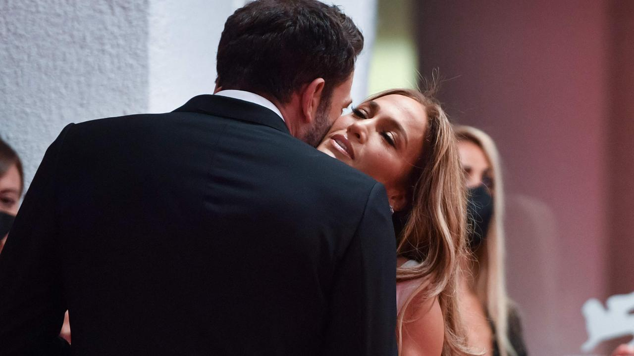 Canoodling on the red carpet. Picture: Filippo Monteforte/AFP