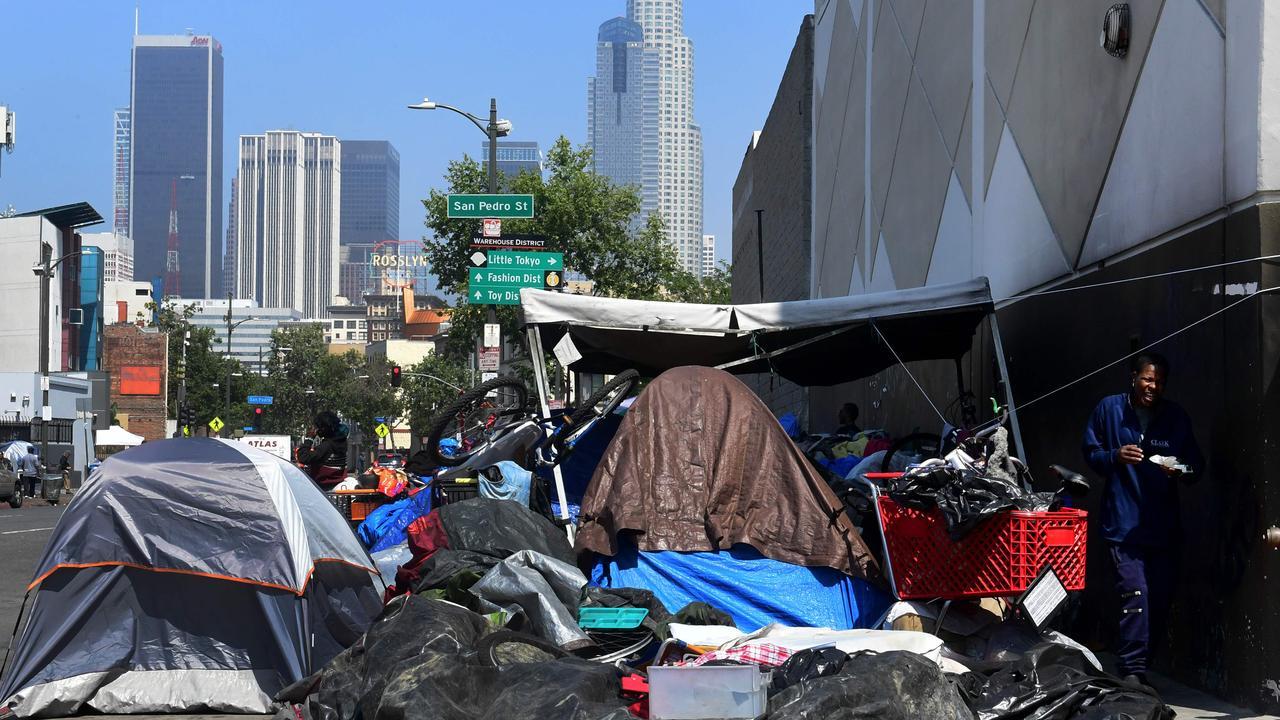 Belongings of the homeless crowd a downtown Los Angeles sidewalk in Skid Row last week. Picture: Frederic J Brown.
