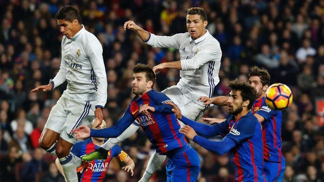 Real Madrid's French defender Raphael Varane (topL) heads the ball.