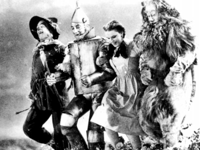 """Scarecrow (actor Ray Bolger), Tinman (Jack Haley), Dorothy (Judy Garland) & Cowardly Lion (Bert Lahr) from 1939 film, """"The Wizard of Oz"""". Films"""