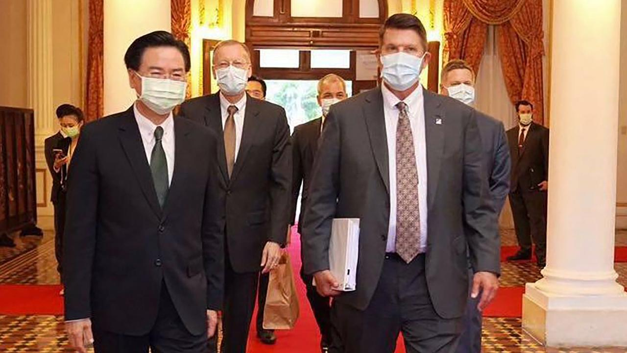 China deploying the fighters and bomber was in response to US Undersecretary of State for Economic Growth, Energy and the Environment, Keith Krach, right, visiting Taiwan. Seen here walking with Taiwan's Foreign Minister Joseph Wu, left. Picture: AFP PHOTO / TAIWAN MINISTRY OF FOREIGN AFFAIRS.