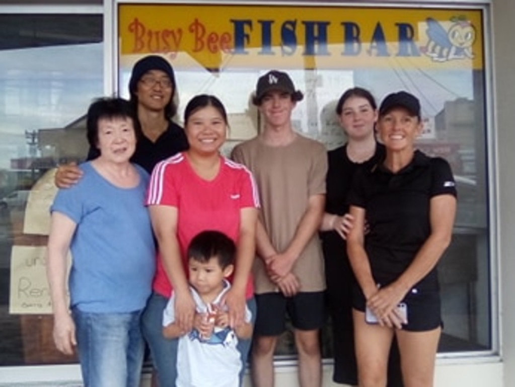 L to R: Lin and Andrew Wong, new owner Sandy Li with her son and the Nelson family – Hamish, Zoe and Lucinda.