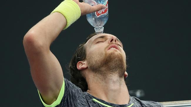 Joao Sousa, during his match with Australian Jordan Thompson, feels the heat on court. Picture: George Salpigtidis