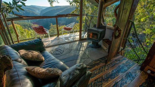 17/20Treehouse Blue Mountains, Bilpin NSW This treehouse in the wilderness that overlooks the Blue Mountains rainforest with its floor to ceiling windows, also has a fireplace and spa. Picture: Supplied See also: Best glamping spots in NSW
