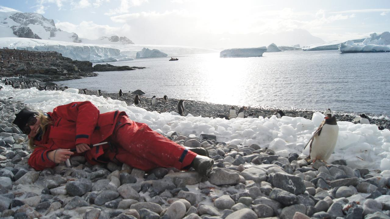 Supplied Travel ANTARCTICA for story by Angela Saurine. Journalist Angela Saurine covered in penguin poo on Cuvervi