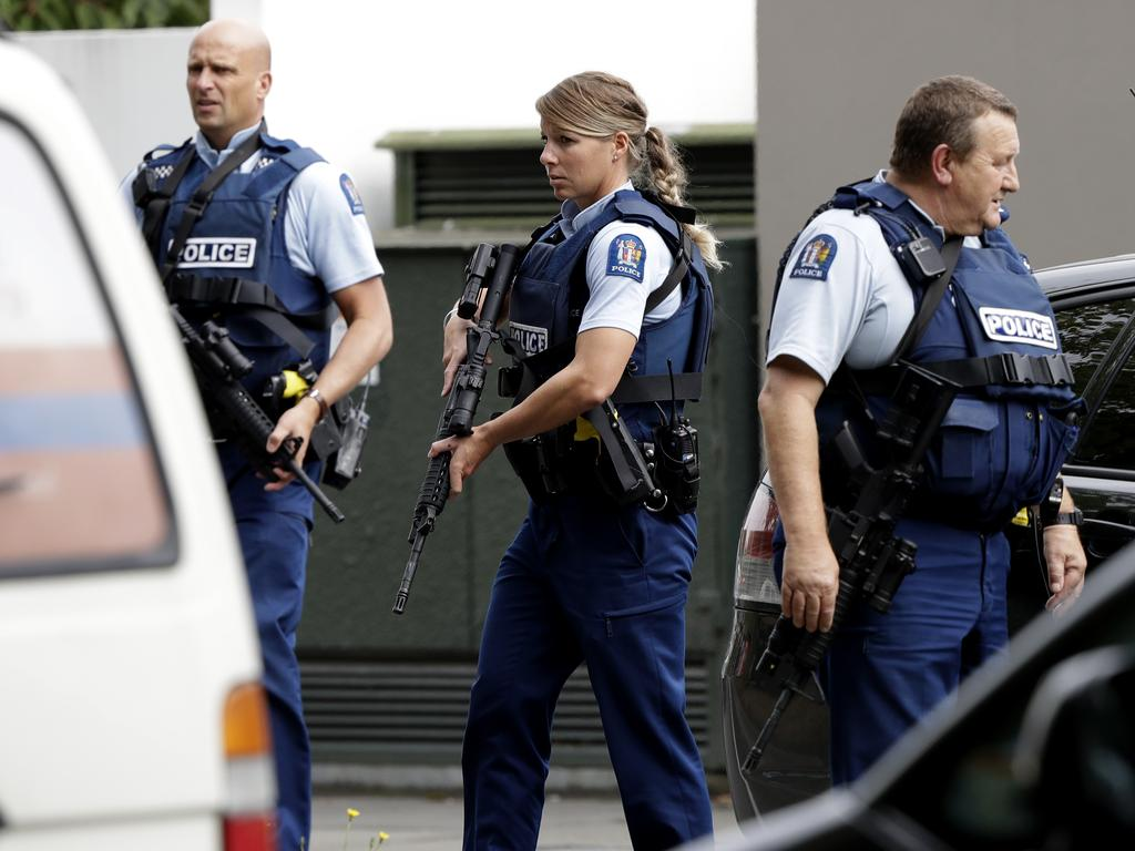 Armed police patrol outside a mosque in Christchurch. Picture: Mark Baker