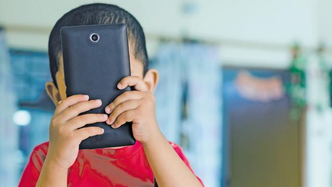 child taking picture with mobile phone camera