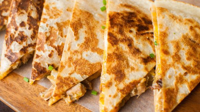 On tonight's hotel room menu? Cheesy quesadillas. Picture: Getty