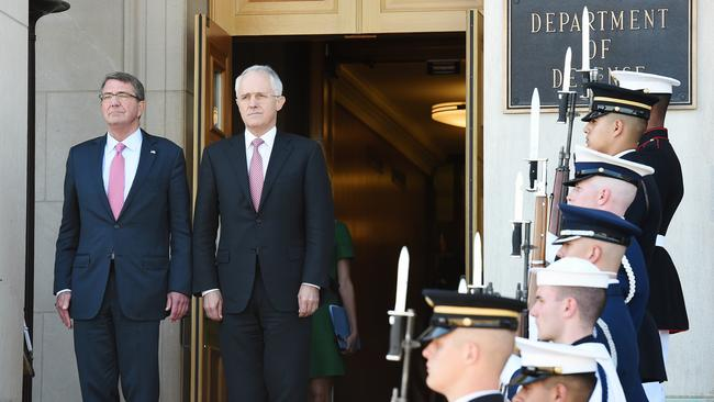 Prime Minister Malcolm Turnbull pictured with Defence Secretary Ash Carter during a Pentagon Honour Cordon in Washington DC. The government is reportedly edging closer to a refugee swap deal with the US. Picture: Jake Nowakowski