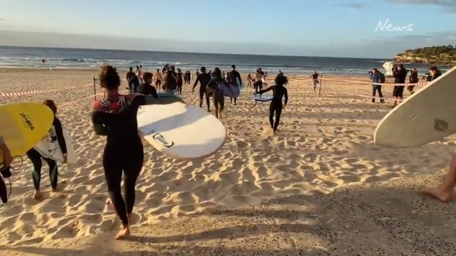 Bondi and Bronte Beaches reopen to surfers and swimmers as Australia flattens the curve