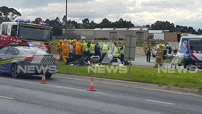 Emergency crews treat victims of the crash.