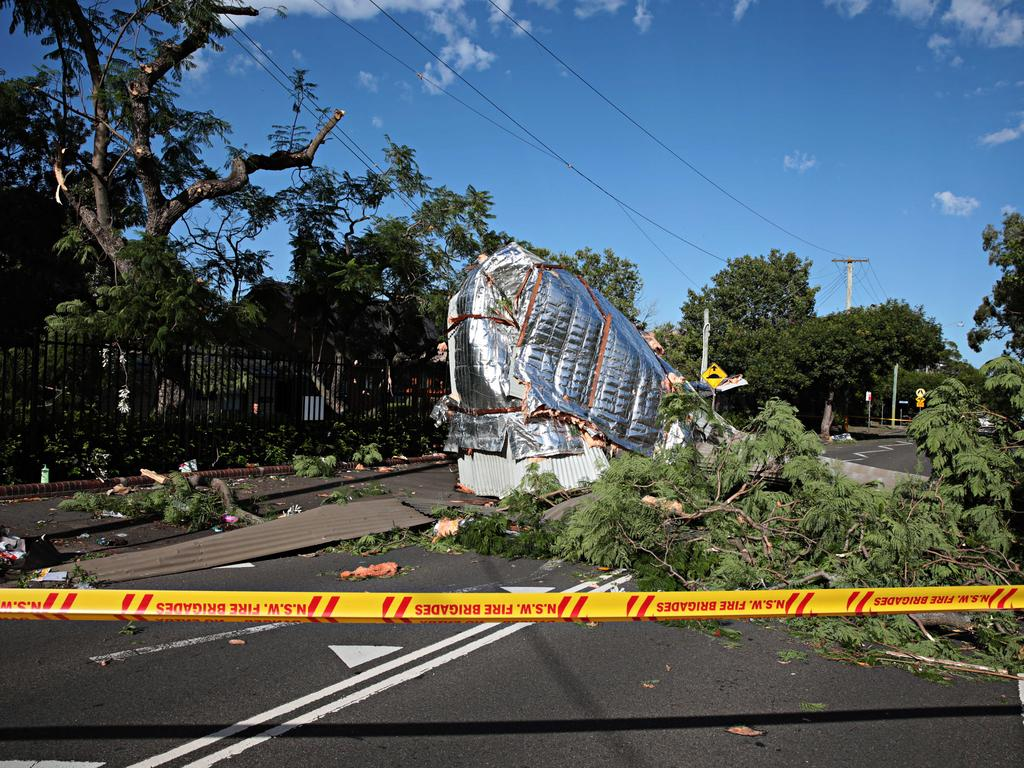 Roof off a classroom from North Parramatta public school laying across power lines on Albert St North Parramatta today. Picture: Adam Yip