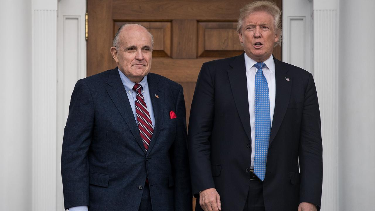 In November 2016, Rudy Giuliani with president-elect Donald Trump at Trump International Golf Club. Picture: Drew Angerer/Getty Images