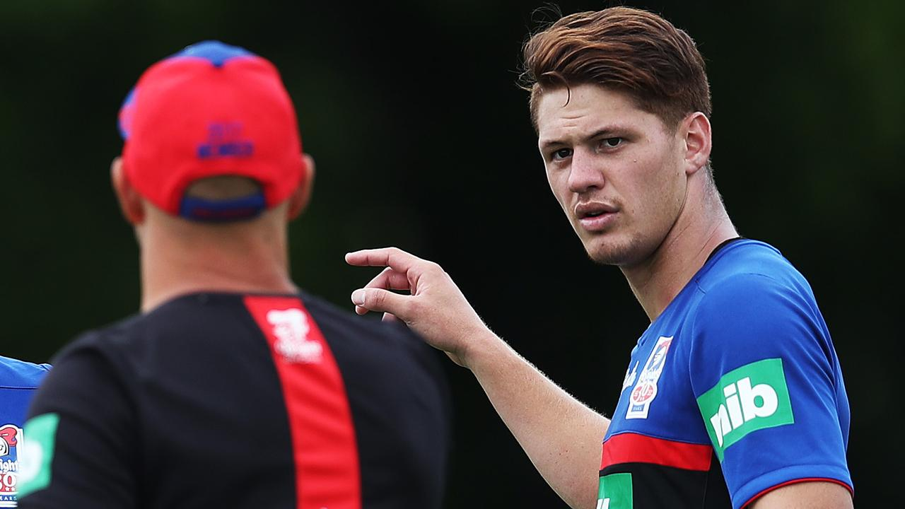 Kalyn Ponga chats with coach Nathan Brown during Newcastle Knights training.