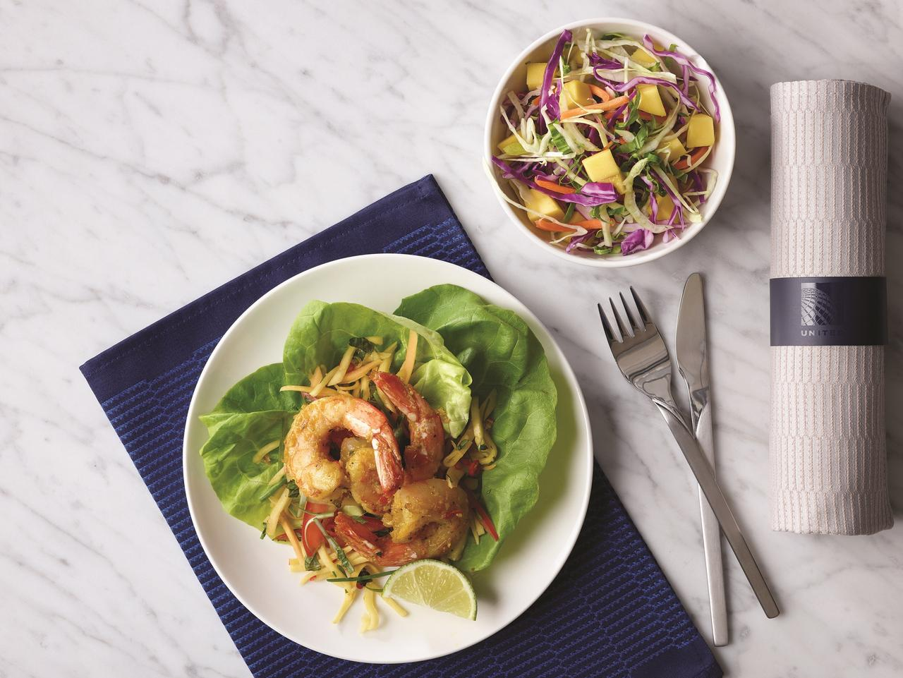 SUNDAY ESCAPE. AMANDA WOODS. UNITED FLIGHT SYDNEY TO HOUSTON. Shrimp appetiser on board United Airlines' Polaris business class. Picture: Supplied