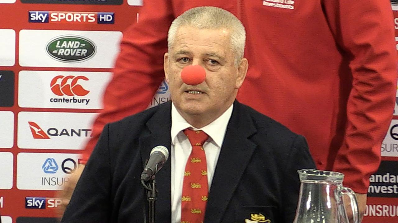 Lions coach Warren Gatland wears a red nose during a press conference.