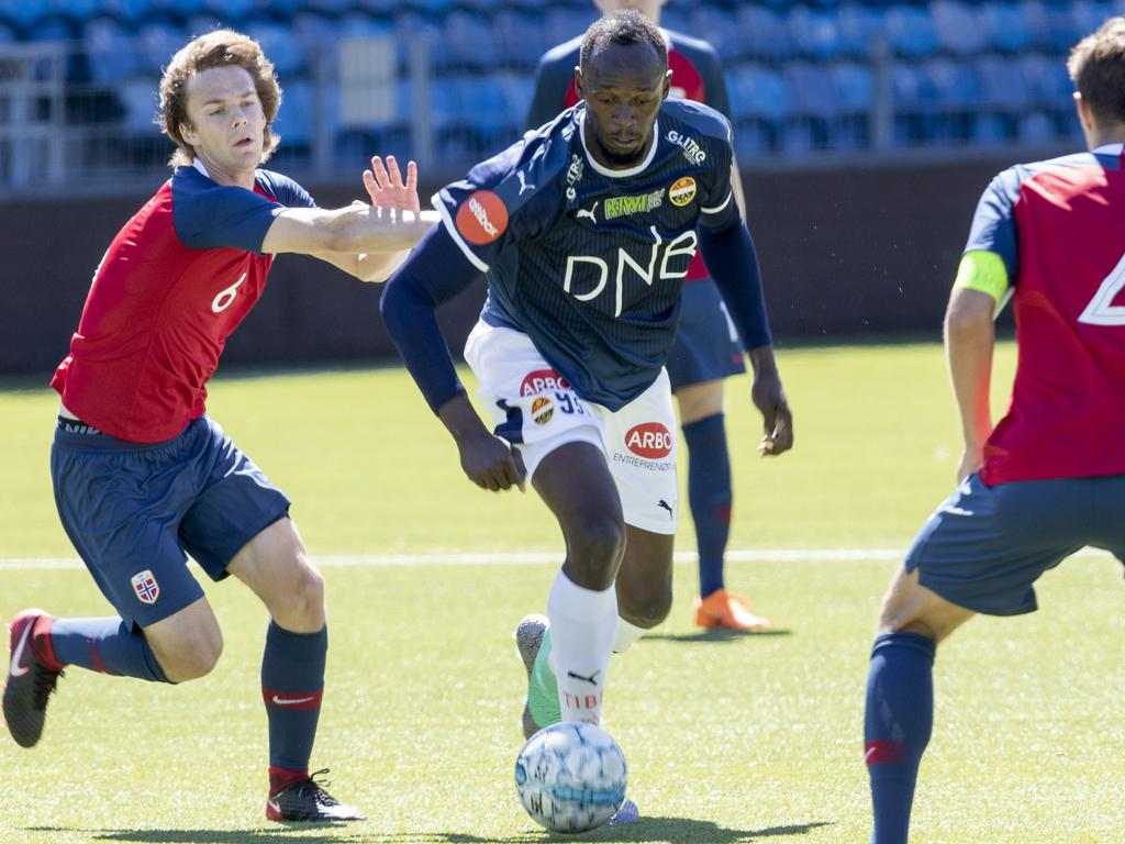 7303fd16808 Usain Bolt (centre) playing for Stromsgodset against Norway s U19s in  Drammen