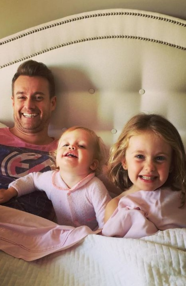 Grant recovering at home with his daughters. Picture: Grant Denyer/Instagram