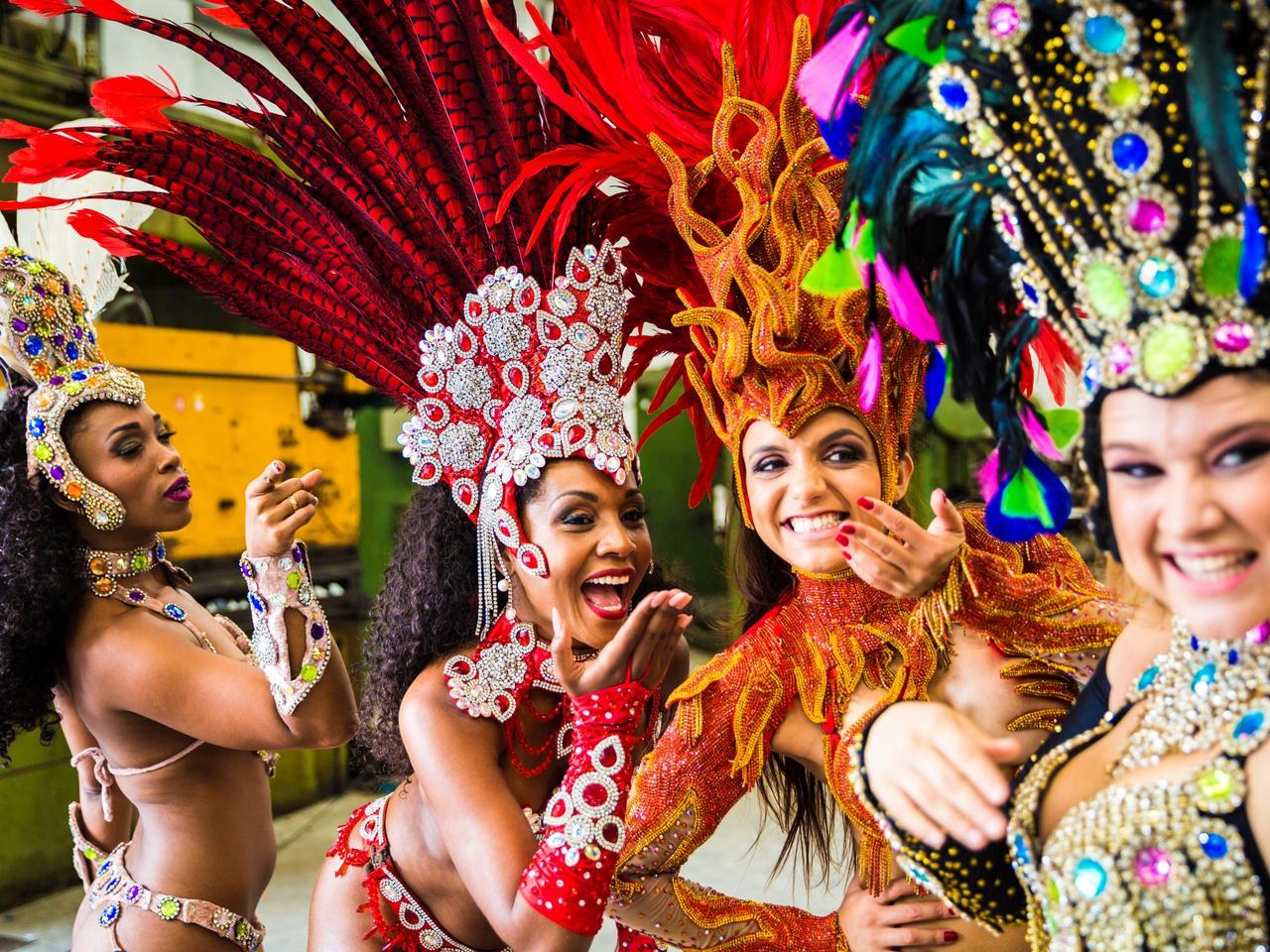 Brazilian women wearing carnival costume in an old factory