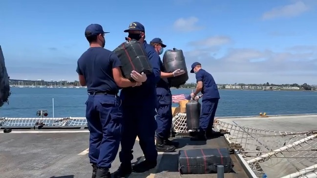 Coast Guard Sailors Offload Bales of Marijuana Captured at Sea