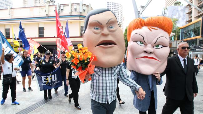 Protestors dressed as caricatures of Queensland Opposition Leader Tim Nicholls and One Nation Leader Senator Pauline Hanson are seen as unionist march in Brisbane.  Picture: AAP Image/Jono Searle