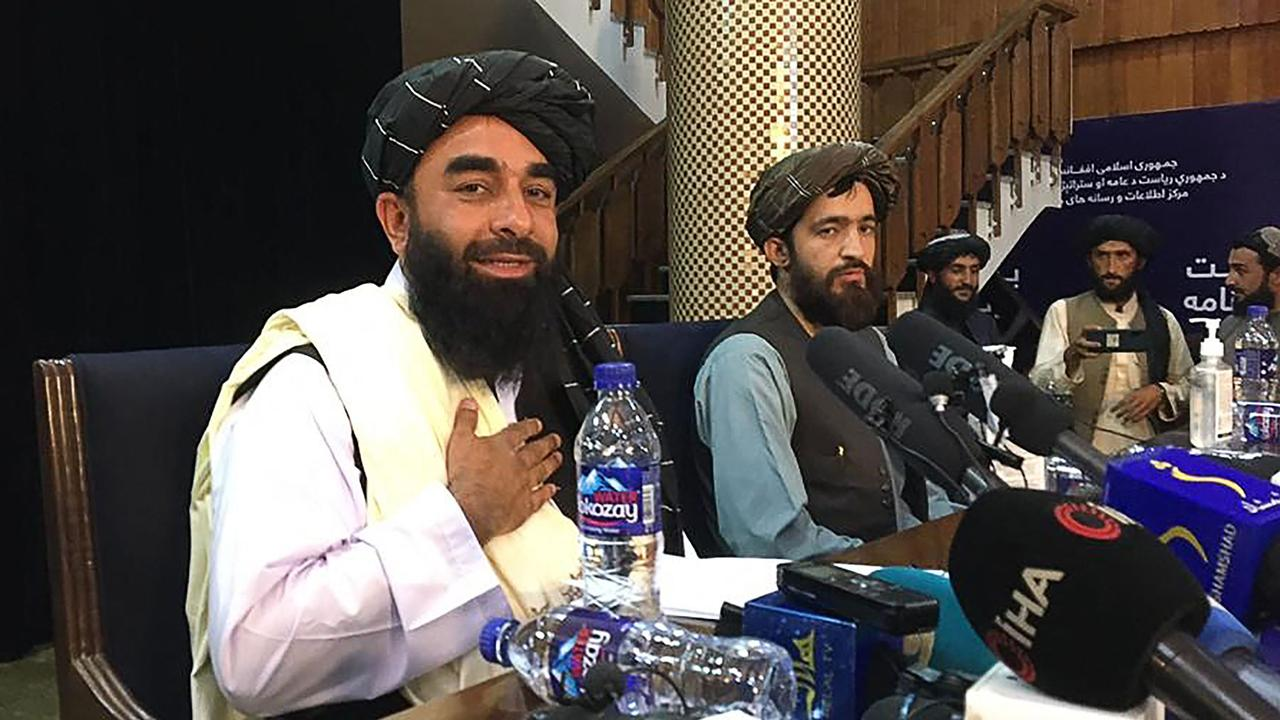 Taliban spokesperson Zabihullah Mujahid (L) gestures as he arrives to hold the first press conference in Kabul on August 17 following the Taliban's stunning takeover of Afghanistan. Picture: Hoshang Hashimi/AFP