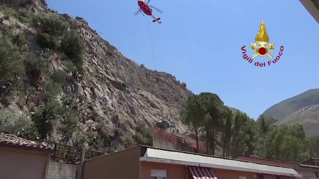Helicopter Wreck Airlifted From Crash Site in Sicily