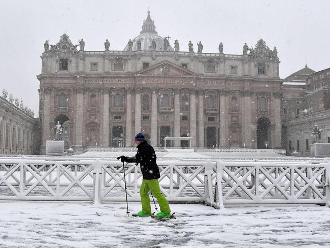 A man skies past St Peter's square. Picture: AFP