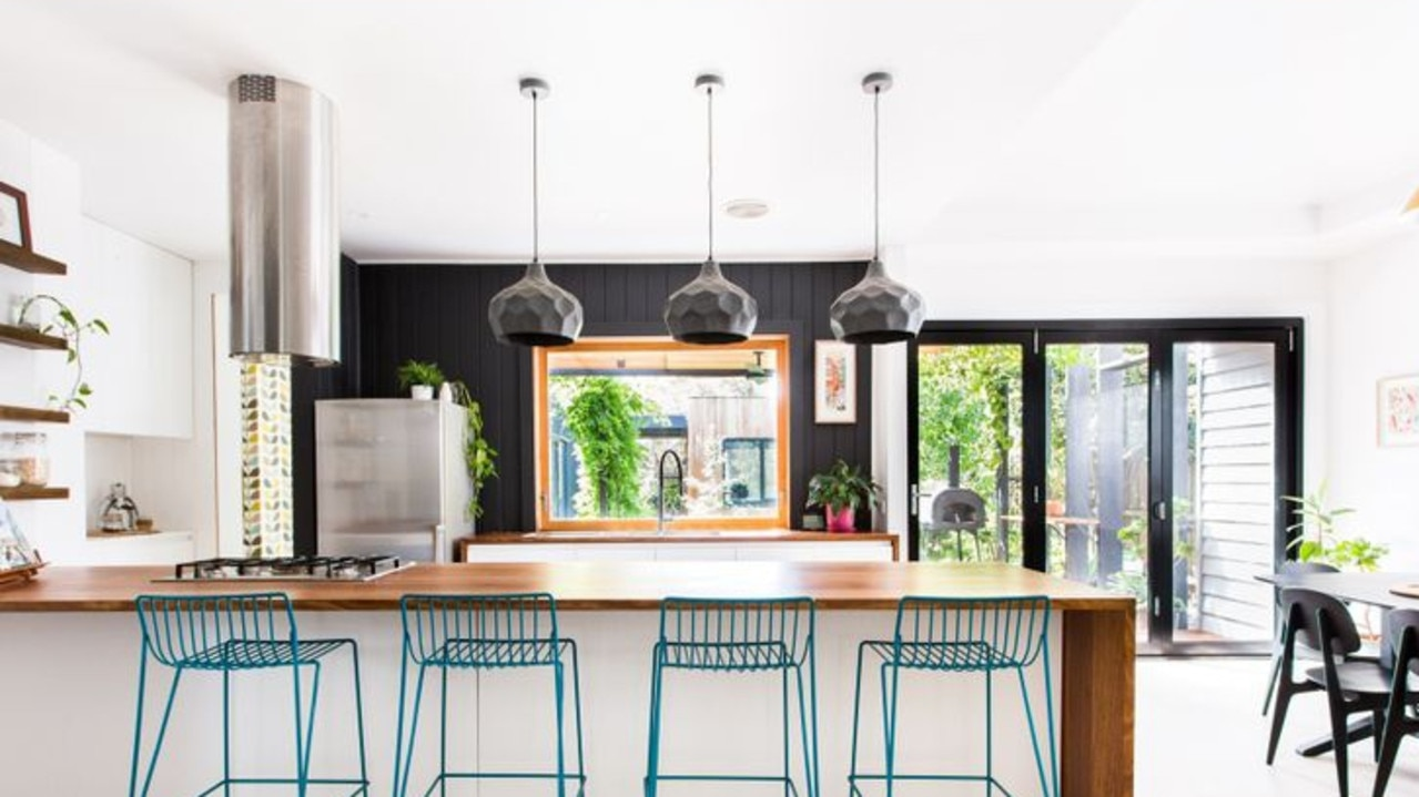 The kitchen incorporates a number of different elements and a bold colour scheme.