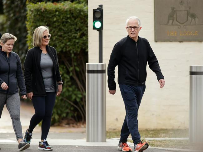 Former PM Malcolm Turnbull with his wife Lucy and daughter Daisy leaving The Lodge in Canberra for a walk. Picture: Jonathan Ng