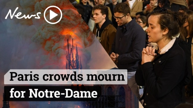 Notre Dame fire: Parisians sing hymns to mourn the iconic cathedral