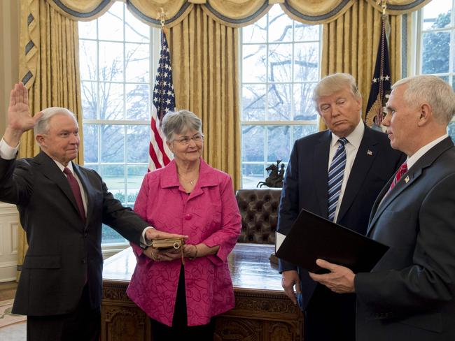 US President Donald Trump (2nd R) watches as Jeff Sessions (L), alongside his wife Mary (2nd L), is sworn in as Attorney-General by US Vice President Mike Pence (R). Picture: AFP