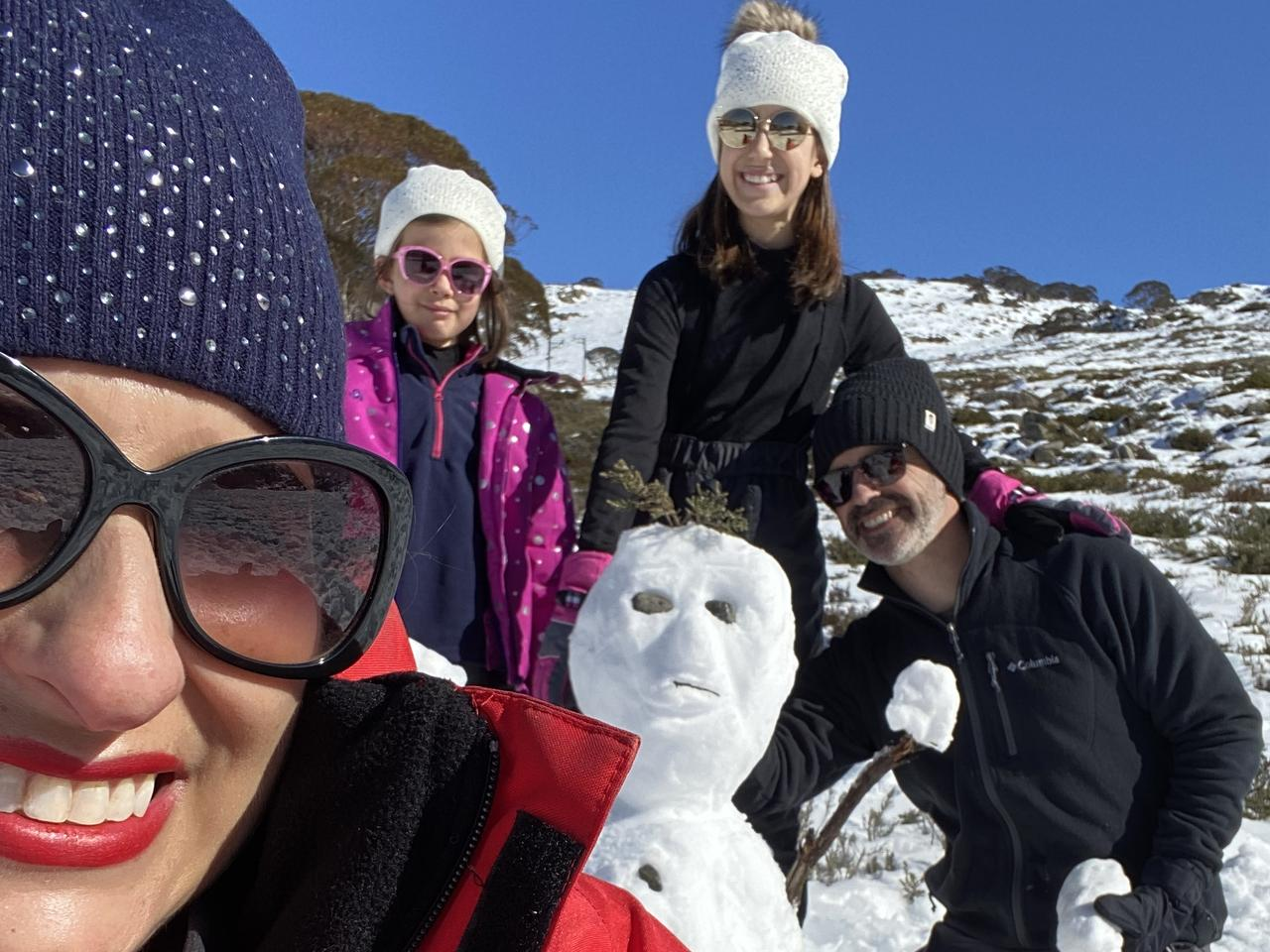 Dilvin Yasa builds a snomwan with her family at a ski field in News South Wales.