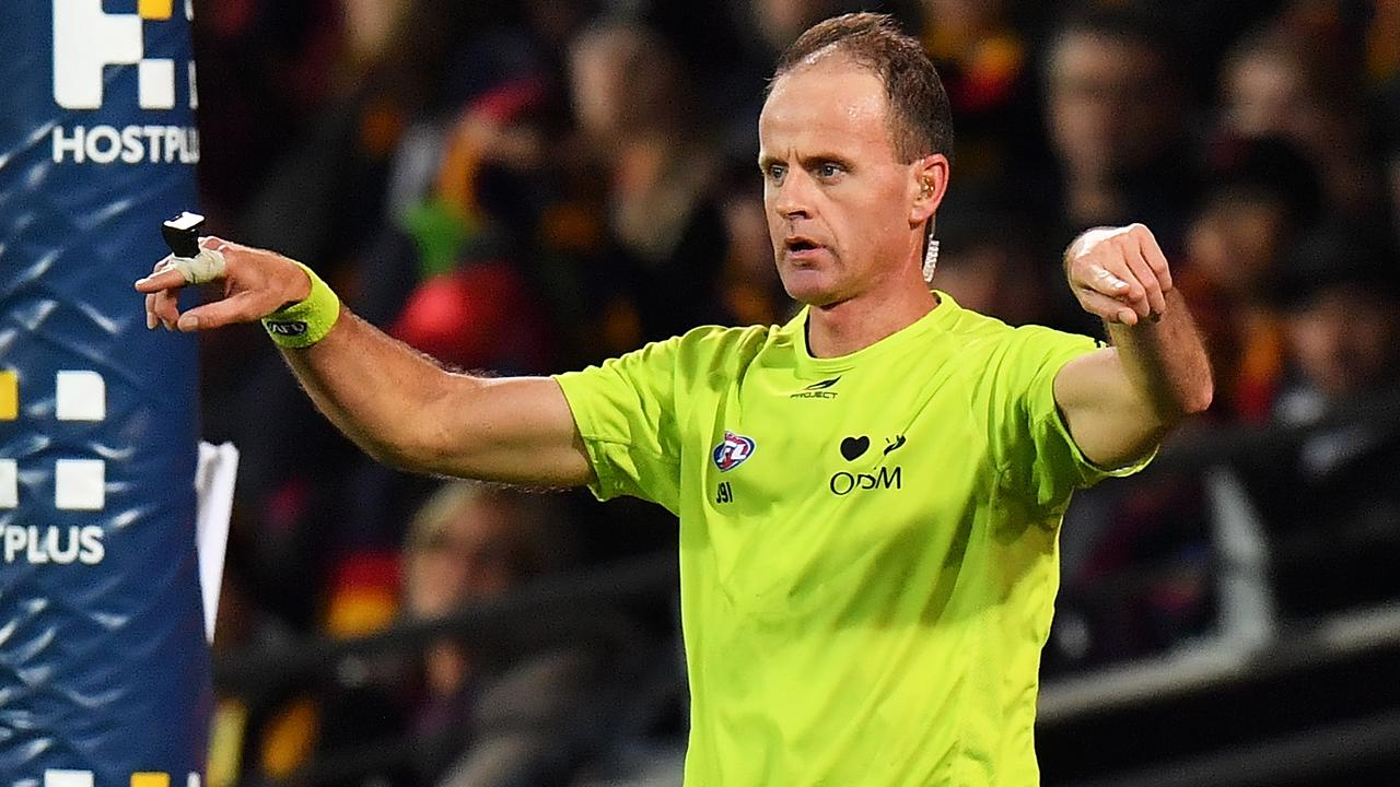 An umpire calls for a score review during an AFL match. (Photo by Daniel Kalisz/Getty Images)