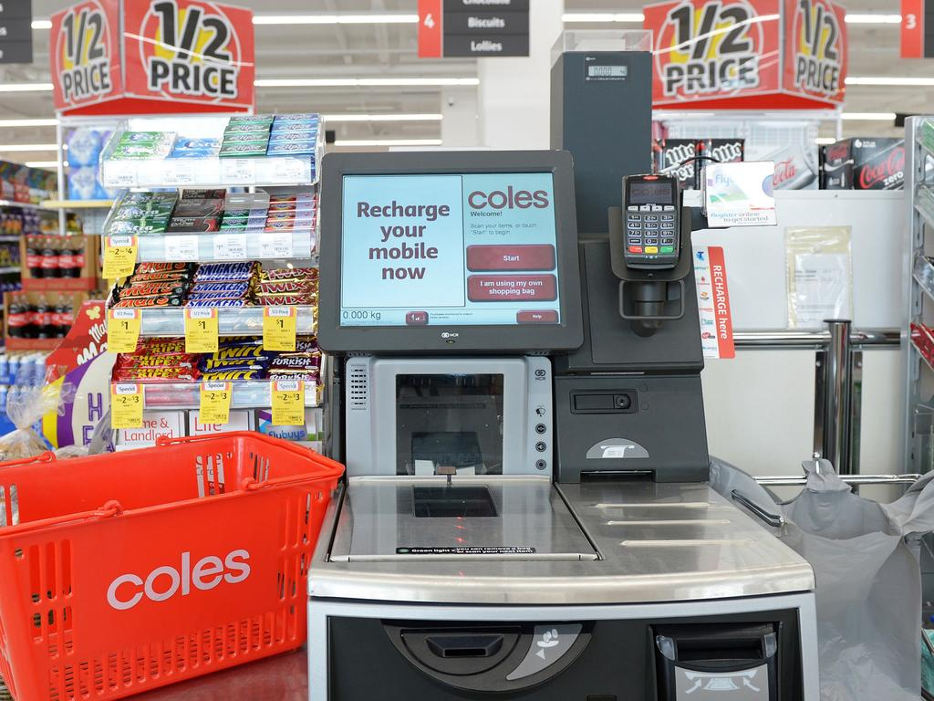 A shopping basket is arranged for a photograph next to a self checkout counter in a Coles supermarket, operated by Wesfarmers Ltd., in Melbourne, Australia, on Tuesday, Feb. 23, 2016. Wesfarmers, Australia's largest retailer, is scheduled to report interim results on Feb. 24. Photographer: Carla Gottgens/Bloomberg via Getty Images