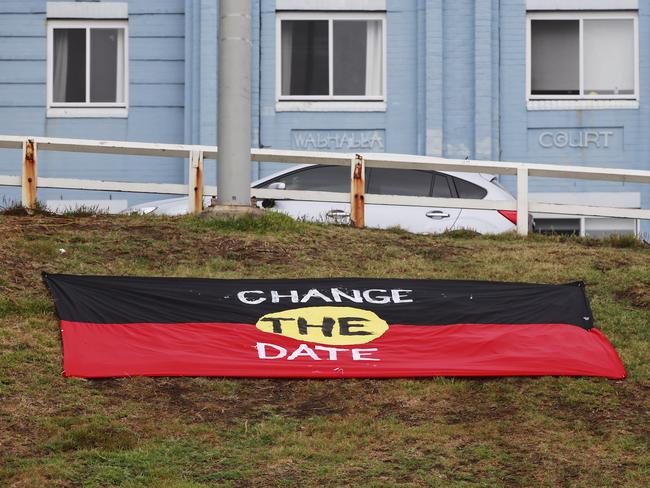 An Aboriginal protest flag is laid out at the southern end of Bondi Beach on Australia Day. Picture: Dylan Robinson