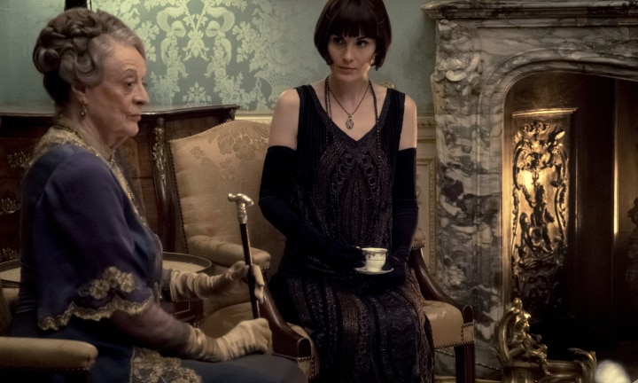 "This image released by Focus Features shows Dame Maggie Smith as The Dowager Countess of Grantham and Michelle Dockery as Lady Mary Talbot in ""Downton Abbey"". The film will be released Sept. 13, 2019, in the United Kingdom and on Sept. 20 in the United States. (Jaap Buitendijk/Focus Features via AP)"