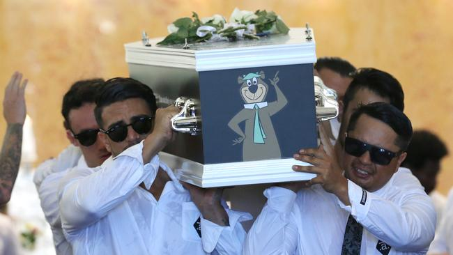 Friends and relatives carry the coffin of Johann Ofner, the stuntman who was killed while filming a music video in Brisbane, during his funeral at the Sacred Heart Church, Clear Island Waters, Gold Coast. Photo: Regi Varghese